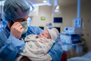 denver-cesarean-birth-photography-dad-holds-baby